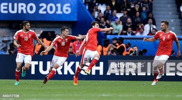 Switzerland's forward Admir Mehmedi celebrates after scoring his team's first goal during the Euro 2016 group A football match between Romania and...