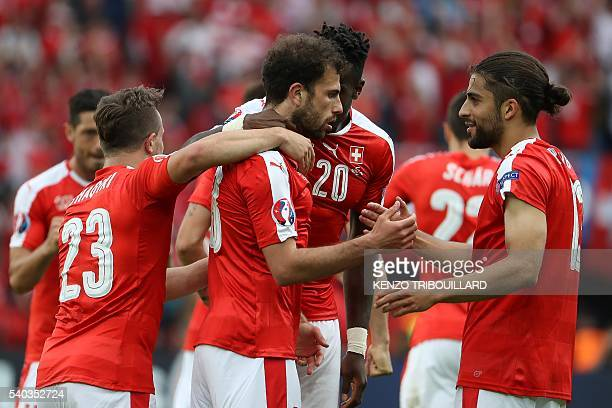 Switzerland's forward Admir Mehmedi celebrates with team mates after scoring a goal during the Euro 2016 group A football match between Romania and...