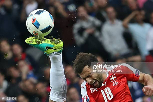 TOPSHOT Switzerland's forward Admir Mehmedi vies for the ball during the Euro 2016 group A football match between Switzerland and France at the...