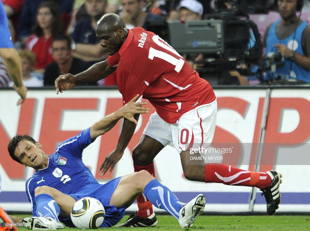 Switzerland's forward Blaise Nkufo (R) fights for the ball with Italy's defender Christian Maggio during the friendly football match Switzerland vs Italy in Geneva's stadium on June 5, 2010 ahead of the FIFA 2010 World Cup in South Africa.