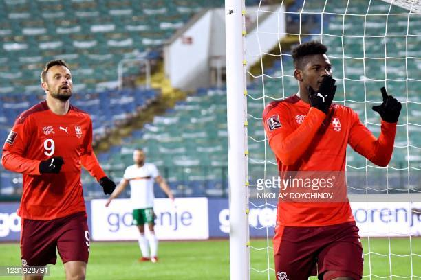 Switzerland's forward Breel Embolo celebrates after scoring a goal during the FIFA World Cup Qatar 2022 Group C qualification football match between...