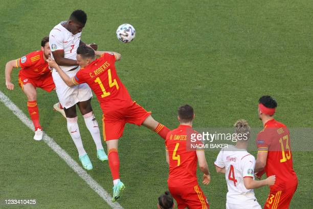 Switzerland's forward Breel Embolo heads the ball to score his teams first goal during the UEFA EURO 2020 Group A football match between Wales and...