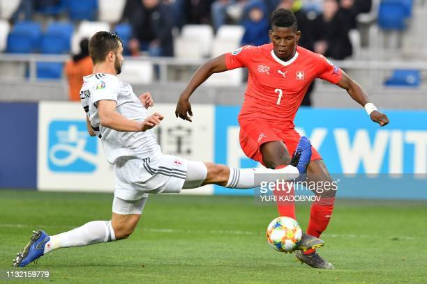 Switzerland's forward Breel Embolo in action during the Euro 2020 football qualification match between Georgia and Switzerland in Tbilisi on March 23...