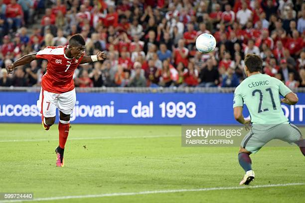 Switzerland's forward Breel Embolo scores his team's first goal against Portugal's goalkeeper Rui Patricio during the World Cup 2018 football...
