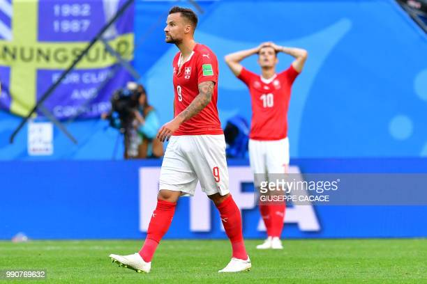 Switzerland's forward Haris Seferovic and midfielder Granit Xhaka react after losing the Russia 2018 World Cup round of 16 football match between...