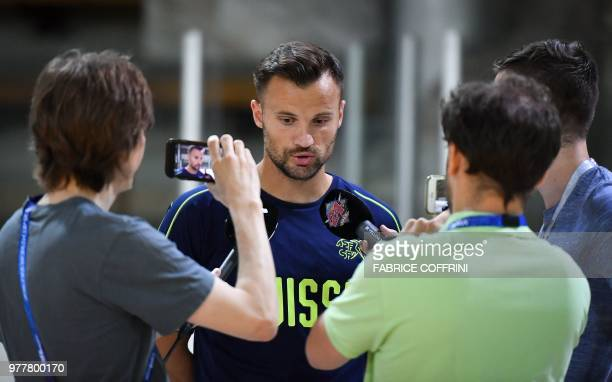 Switzerland's forward Haris Seferovic answers a journalist's question during a press conference on June 18 2018 at Torpedo Stadium in Tolyatti also...