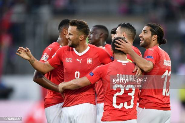 Switzerland's forward Haris Seferovic celebrate with teammates after scoring the team fourth goal during the UEFA Nations League football match...