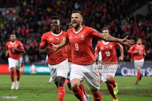 Switzerland's forward Haris Seferovic celebrates scoring his team's first goal during the Euro 2020 football qualification match between Switzerland...