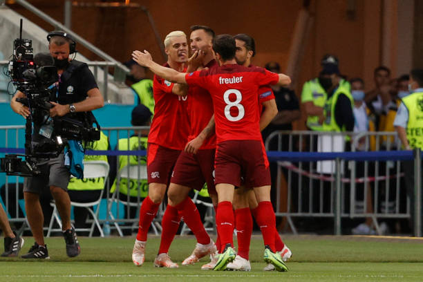 Switzerland's forward Haris Seferovic celebrates scoring the opening goal with his teammates during the UEFA EURO 2020 Group A football match between...