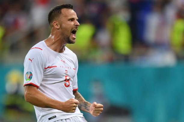 Switzerland's forward Haris Seferovic celebrates scoring the team's first goal during the UEFA EURO 2020 round of 16 football match between France...