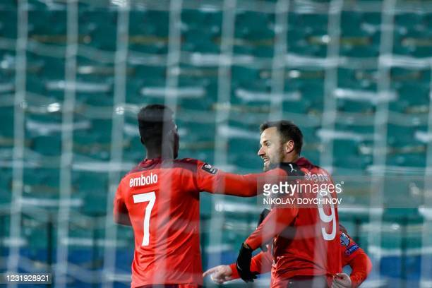 Switzerland's forward Haris Seferovic celebrates with teammate Switzerland's forward Breel Embolo after scoring a goal during the FIFA World Cup...