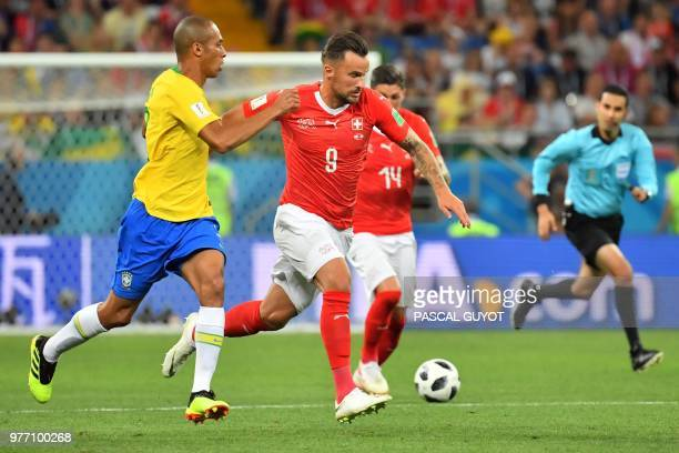 Switzerland's forward Haris Seferovic controls the ball during the Russia 2018 World Cup Group E football match between Brazil and Switzerland at the...