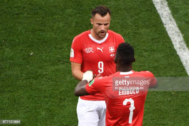 Switzerland's forward Haris Seferovic is substituted by Switzerland's forward Breel Embolo during the Russia 2018 World Cup Group E football match...
