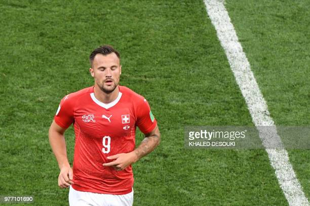 Switzerland's forward Haris Seferovic leaves the pitch during the Russia 2018 World Cup Group E football match between Brazil and Switzerland at the...