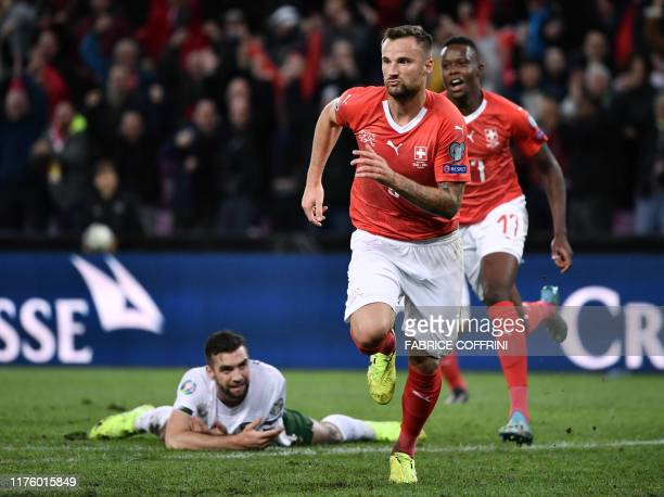 Switzerland's forward Haris Seferovic reacts after scoring his team's first goal during the Euro 2020 Group D qualification football match between...
