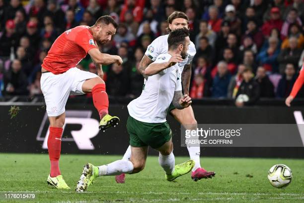 Switzerland's forward Haris Seferovic scores his team's first goal during the Euro 2020 football qualification match between Switzerland and Ireland...