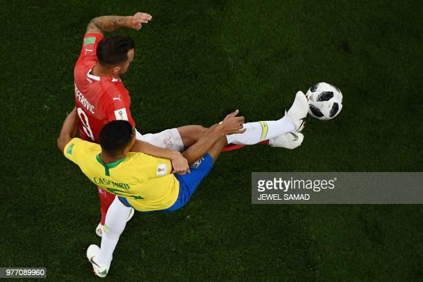 Switzerland's forward Haris Seferovic vies with Brazil's midfielder Casemiro during the Russia 2018 World Cup Group E football match between Brazil...