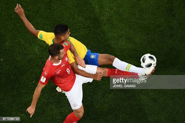 TOPSHOT Switzerland's forward Haris Seferovic vies with Brazil's midfielder Casemiro during the Russia 2018 World Cup Group E football match between...