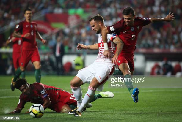 Switzerland's forward Haris Seferovic vies with Portugal's defender Pepe and Portugal's defender Eliseu during the FIFA 2018 World Cup Qualifier...