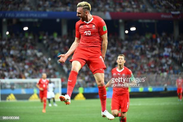 TOPSHOT Switzerland's forward Josip Drmic celebrates after scoring his team's second goal during the Russia 2018 World Cup Group E football match...