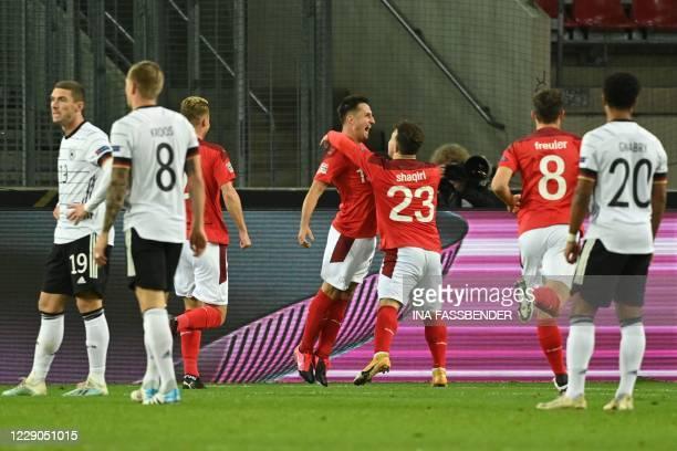 Switzerland's forward Josip Drmic celebrates scoring with his team-mate Switzerland's midfielder Xherdan Shaqiri during the UEFA Nations League...