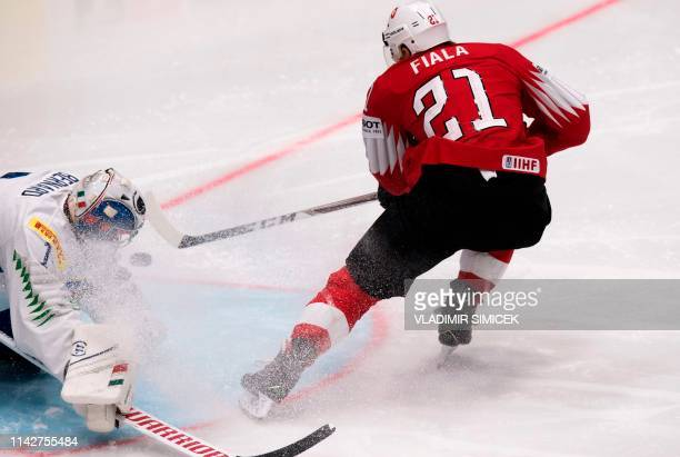 TOPSHOT Switzerland's forward Kevin Fiala scores during the IIHF Men's Ice Hockey World Championships Group B match between Switzerland and Italy on...