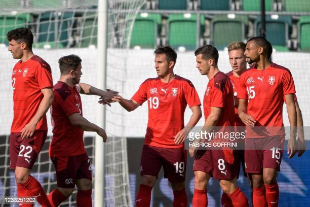 Switzerland's forward Mario Gavranovic celebrates with teammates his team's first goal during a friendly football match between Switzerland and...
