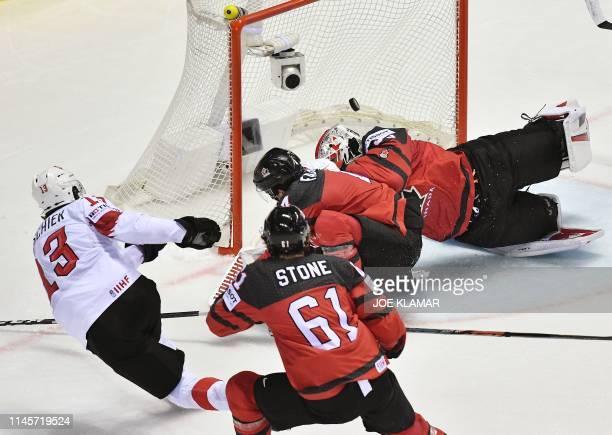 Switzerland's forward Nico Hischier scores during the IIHF Men's Ice Hockey World Championships quarter-final match between Canada and Switzerland on...