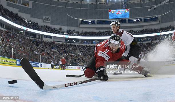 Switzerland's forward Thomas Rufenacht falls as he fails to score during a preliminary round group B match between Latvia and Switzerland at the IIHF...