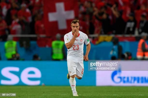 Switzerland's forward Xherdan Shaqiri celebrates scoring during their Russia 2018 World Cup Group E football match between Serbia and Switzerland at...
