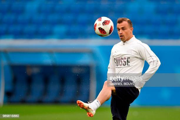 Switzerland's forward Xherdan Shaqiri controls a ball during a training session at the Saint Petersburg Stadium in Saint Petersburg on July 2 2018 on...