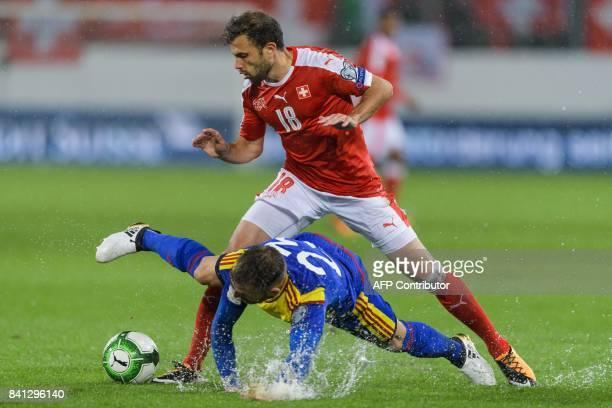 Switzerland's foward Admir Mehmedi vies with Andorra's defender Jordi Rubio during the FIFA World Cup WC 2018 football qualifier between Switzerland...