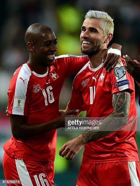 Switzerland's Gelson Fernandes and Valon Behrami celebrate winning the World Cup 2018 football qualification match between Hungary and Switzerland at...