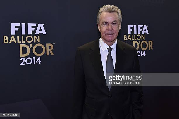 Switzerland's German coach Ottmar Hitzfeld poses as he arrives during the red carpet ceremony ahead of the 2014 FIFA Ballon d'Or award ceremony at...