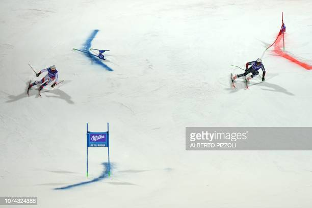 Switzerland's Gino Caviezel and Norway's Henrik Kristoffersen compete in the semi-final of the FIS Alpine World Cup Men's Parallel Giant Slalom...