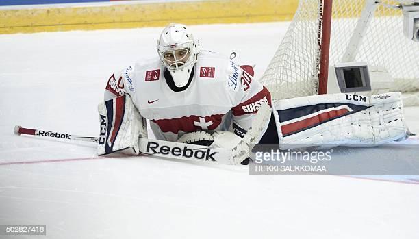 Switzerland's goalie Joren von Pottelberghe lies on ice after the 2016 IIHF World Junior U20 Ice Hockey Championships tournament match Switzerland vs...