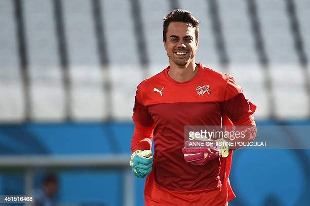 Switzerland's goalkeeper Diego Benaglio runs during the official training session at The Corinthians Arena in Sao Paulo on June 30 ahead of their...