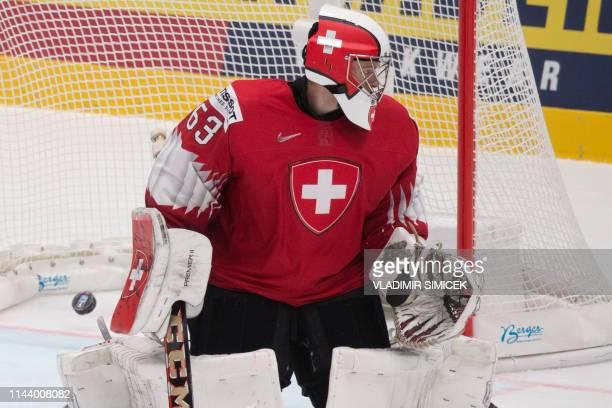 Switzerlands goalkeeper Leonardo Genoni fails to make a save during the IIHF Men's Ice Hockey World Championships Group B match between Switzerland...