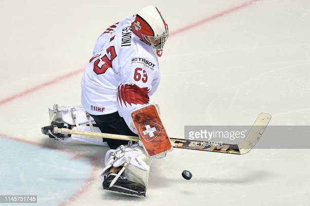 Switzerland's goalkeeper Leonardo Genoni saves the puck during the IIHF Men's Ice Hockey World Championships quarter-final match between Canada and...