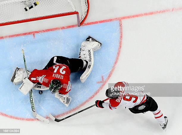 Switzerland's goalkeeper Martin Gerber makes a save of Canada's Matt Duchene shot during the preliminary round match Switzerland vs Canada at the...