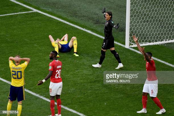 Switzerland's goalkeeper Yann Sommer and Switzerland's defender Manuel Akanji react during the Russia 2018 World Cup round of 16 football match...
