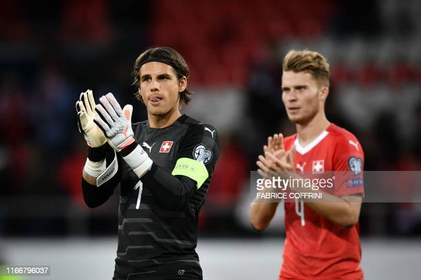 Switzerland's goalkeeper Yann Sommer and Switzerland's defender Nico Elvedi applause at the end of the Euro 2020 qualifying football match between...