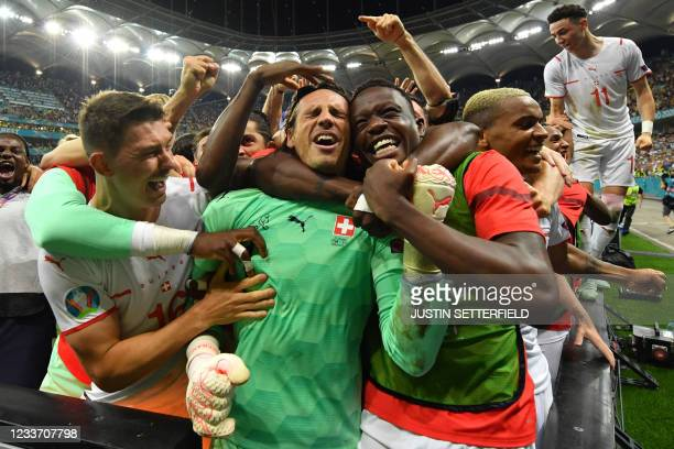 Switzerland's goalkeeper Yann Sommer and teammates celebrate their win in the UEFA EURO 2020 round of 16 football match between France and...