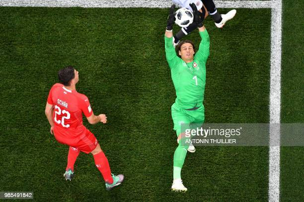TOPSHOT Switzerland's goalkeeper Yann Sommer catches the ball during the Russia 2018 World Cup Group E football match between Switzerland and Costa...