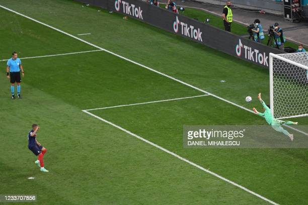 Switzerland's goalkeeper Yann Sommer deflects a shot by France's forward Kylian Mbappe in the penalty shootout during the UEFA EURO 2020 round of 16...