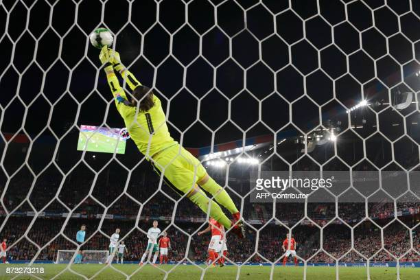Switzerland's goalkeeper Yann Sommer deflects the ball during the FIFA 2018 World Cup playoff second leg qualifiying football match between...