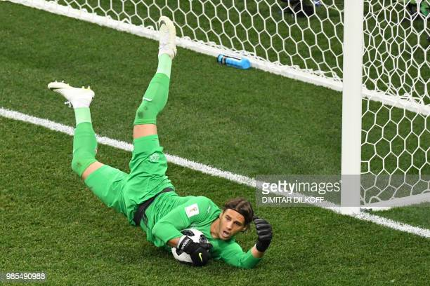 TOPSHOT Switzerland's goalkeeper Yann Sommer dives for the ball during the Russia 2018 World Cup Group E football match between Switzerland and Costa...