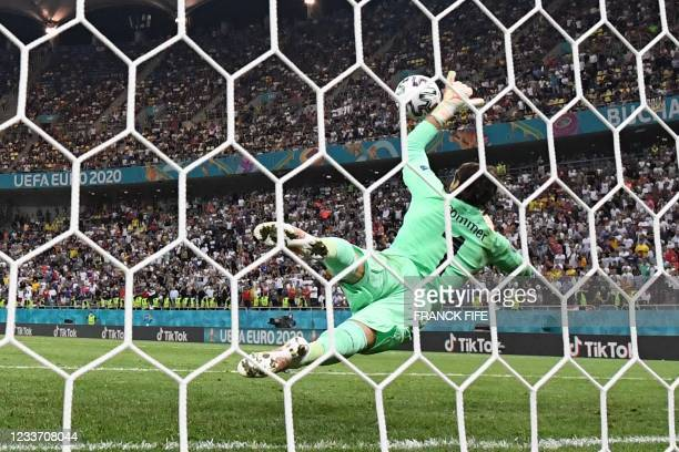Switzerland's goalkeeper Yann Sommer dives to save a penalty by France's forward Kylian Mbappe during the UEFA EURO 2020 round of 16 football match...