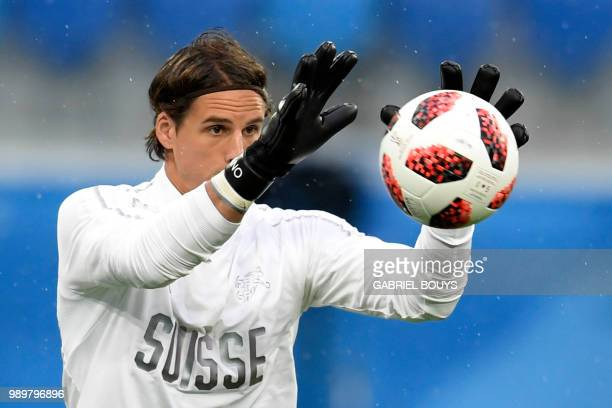 Switzerland's goalkeeper Yann Sommer grabs a ball during a training session at the Saint Petersburg Stadium in Saint Petersburg on July 2, 2018 on...