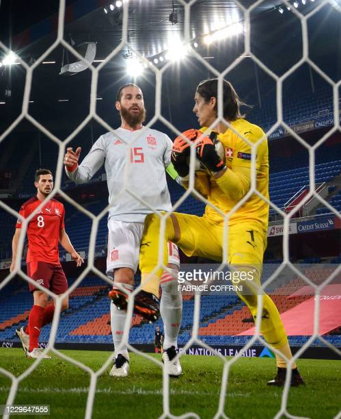 Switzerland's goalkeeper Yann Sommer holds a ball next to Spain's defender Sergio Ramos during the UEFA Nations League league A day 5 group 4...